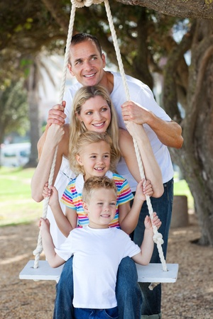 Cheerful family swinging  photo
