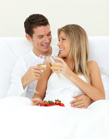 Intimate couple drinking Champagne with strawberries  photo
