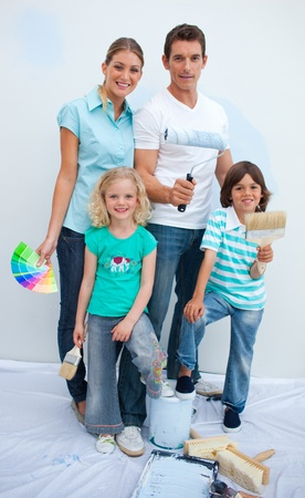 paint samples: Happy family decorating their new house