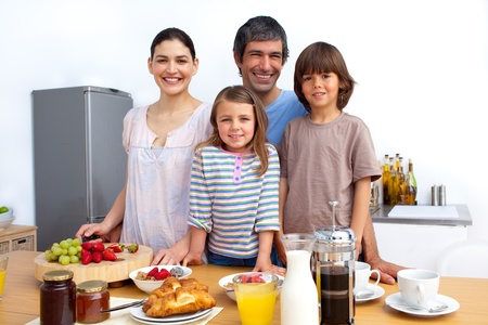 family health: Portrait of a happy family preparing food Stock Photo
