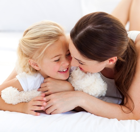 Attentive mother hugging her daughter Stock Photo - 10247827