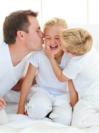 Loving family playing sitting on a bed Stock Photo - 10245934