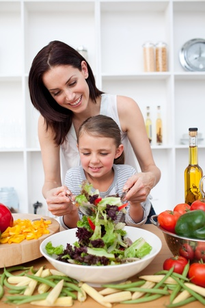 latin food: Little girl cooking with her mother Stock Photo