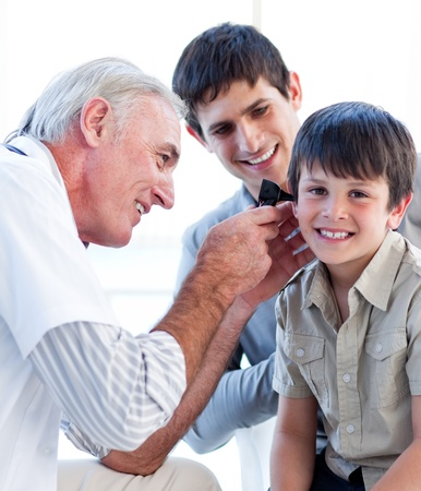 specialists: Senior doctor examining a little boy