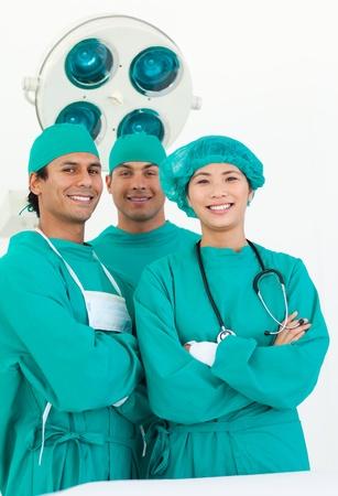 Smiling team of surgeon photo