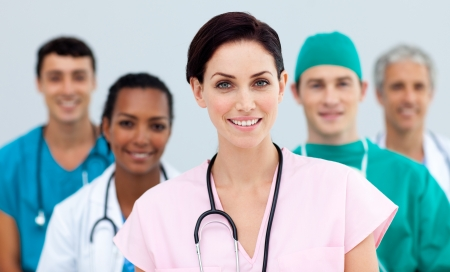 modern doctor: Female Doctor standing in Front of her team