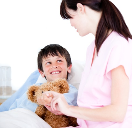 Female Doctor standing in Front of her little patient Stock Photo - 10247770