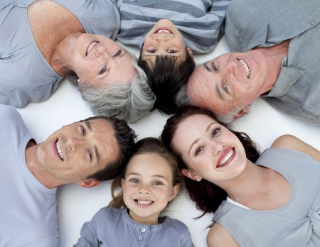 healthy life: High angle of family lying on floor with heads together