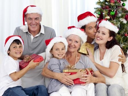 adult christmas: Family giving presents for Christmas