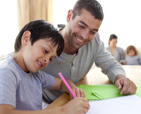 Father helping his son doing homework photo