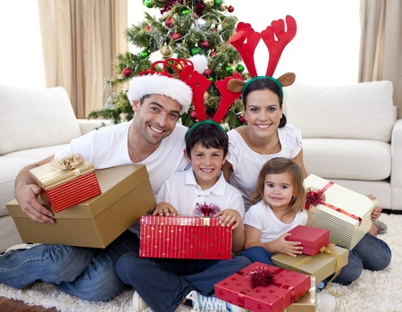 Happy family celebrating Christmas at home photo