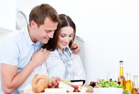 tastes: Portrait of Cute couple preparing a meal Stock Photo
