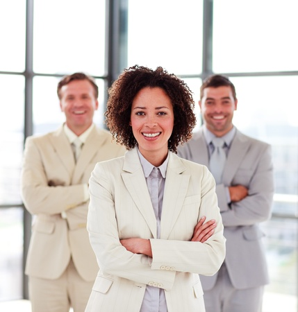 Smiling businesswoman with her team in the background photo