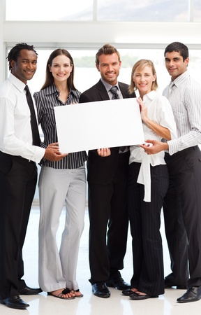 Business people showing a big white card photo