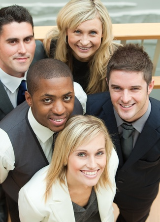 High view of a business team smiling at the camera. Concept of union in business photo