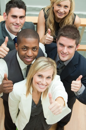 High view of happy business team with thumbs up photo