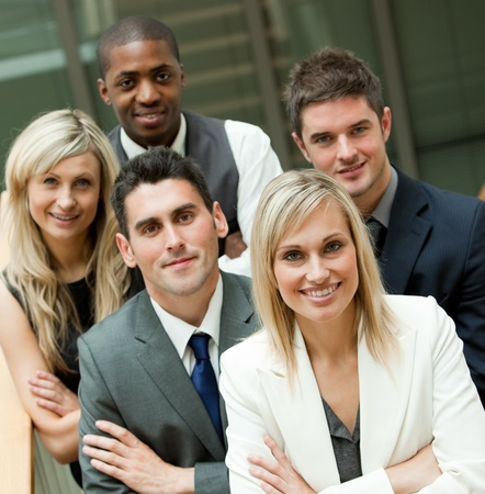 Portrait of a business team smiling at the camera.  photo