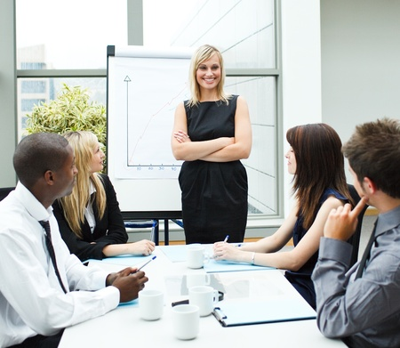 Attractive businesswoman in a meeting with folded arms Stock Photo - 10245944