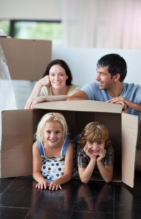 Happy family playing at home with boxes photo
