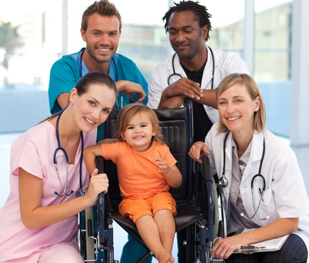 practitioner: Group of doctors with a baby in a wheelchair