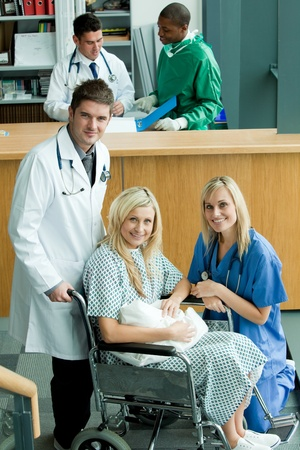 Doctors with a patient and her newborn baby  photo
