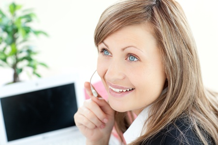 Attractive businesswoman with headset on Stock Photo - 10250230
