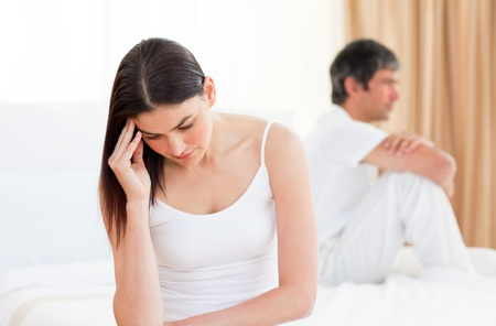 Upset couple sitting sitting separately after having a row  Stock Photo
