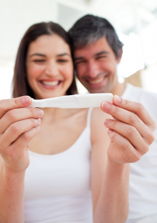 paternity: Cheerful couple finding out results of a pregnancy test