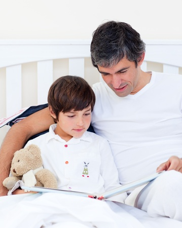 Caring father reading with his son  photo