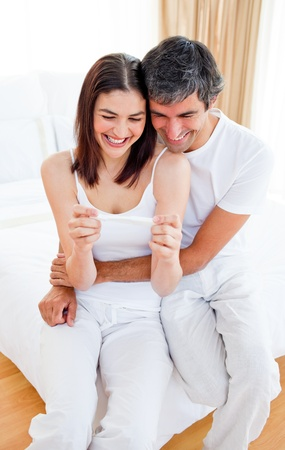 finding out: Happy couple finding out results of a pregnancy test
