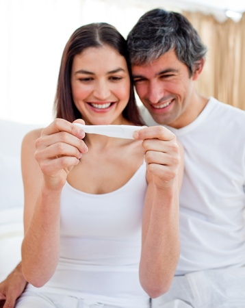 Glowing couple finding out results of a pregnancy test  photo