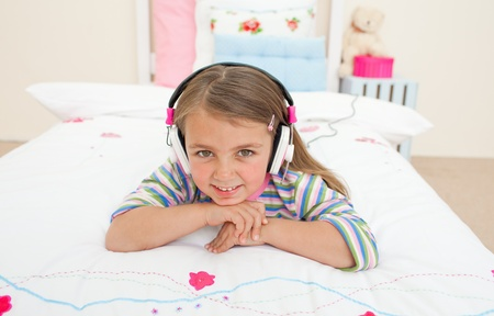 gril: Cute little gril listening to music