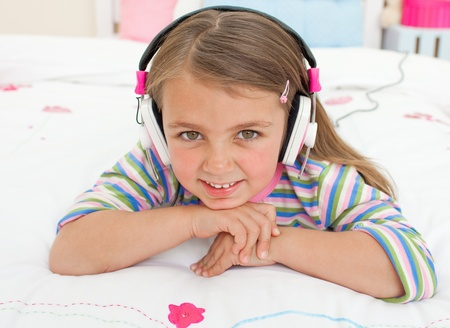gril: Smiling little gril listening to music