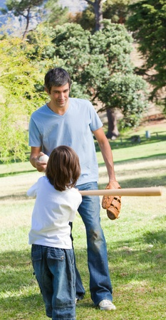 Father and his son playing baseball  photo