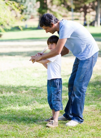 Loving little boy playing baseball with his father photo