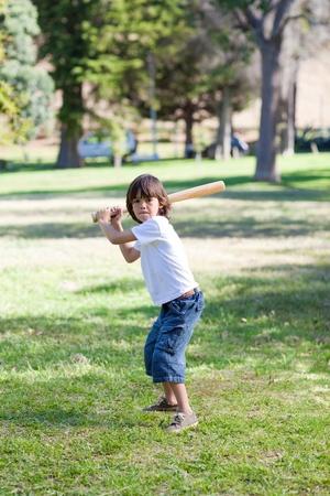 Adorable little boy playing baseball photo