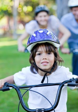 Adorable little boy riding a bike photo