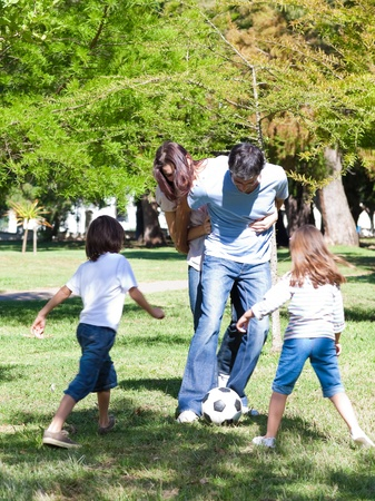 recreational area: Lively family playing soccer