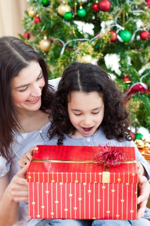 Mother and daughter playing with Christmas gifts photo