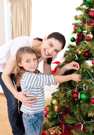 Mother and daughter at home at Christmas time photo