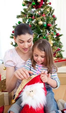 Mother and daughter at home at Christmas photo