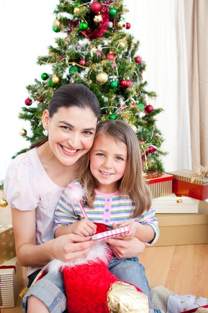Mother and daughter at home at Christmas Stock Photo - 10248871