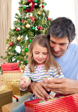 Dad and little girl playing with Christmas presents Stock Photo - 10248819
