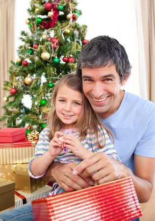 Dad and little girl playing with Christmas presents photo