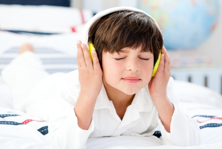 Cute boy listenning music photo