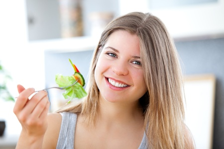 Charming woman with food in a kitchen  photo