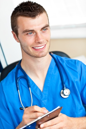 Happy male doctor holding a stethoscope  Stock Photo - 10248167