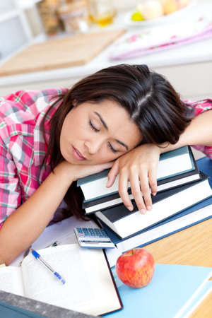 Close-up of a tired caucasian teen girl studying at home Stock Photo - 10249907