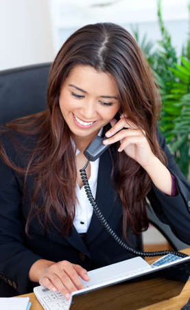 Smiling businesswoman talking on the phone photo