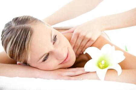 woman massage: Portrait of a cute woman having a massage Stock Photo